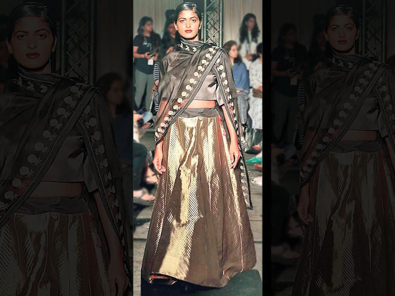 If you want the complete combo with dupatta, this is how you wear it. Designer Sanjay Garg uses black and grey with a metallic tone to create this glamorous, modern-day lehenga look.
