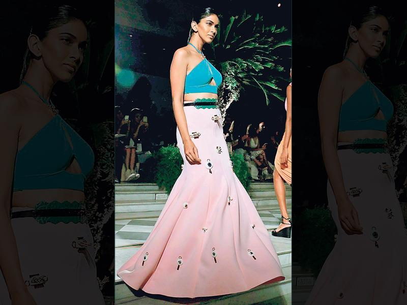 Designer duo Shivan and Narresh played with muted tones of pink and green. A halter blouse with a sexy cut-out paired with a fishtail skirt with appliqué work is perfect for a cocktail party.