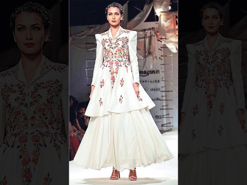 White lehengas are in vogue like never before. Thumbs up to this embroidered long jacket over a voluminous skirt by designer Samant Chauhan.