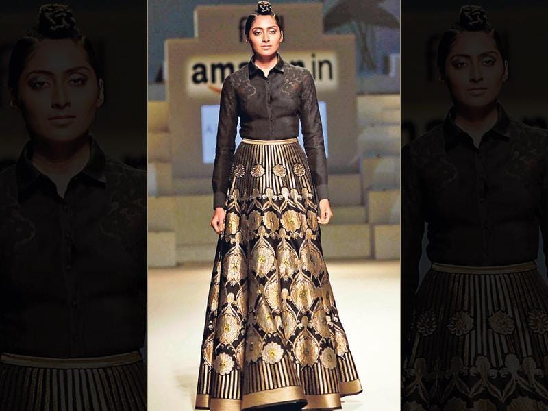 Wearing shirts over lehengas is as cool as it can get. This creation by designer Abhishek Gupta of a buttoned-up, tucked-in shirt with a metallic lehenga is bang on.
