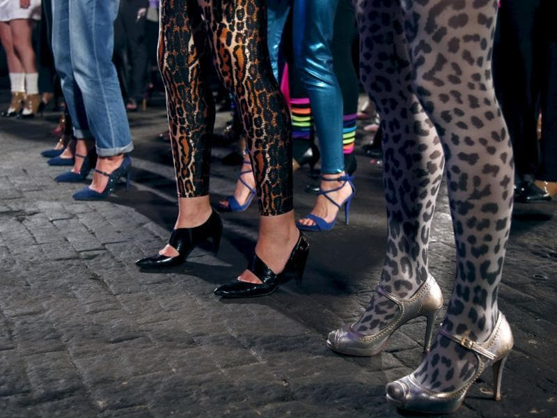 Contestants in animal print pants and high heels. (REUTERS)