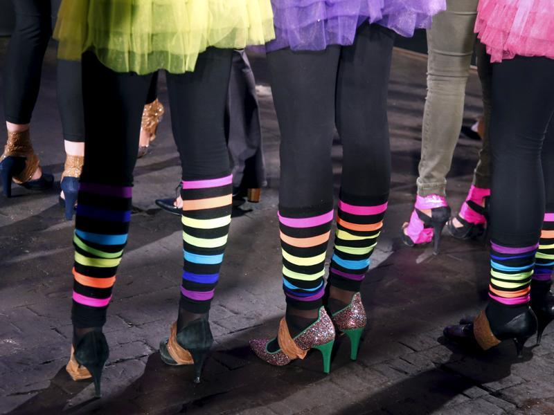 Contestants were seen take precautions for a  high heels race in Paris. (REUTERS)
