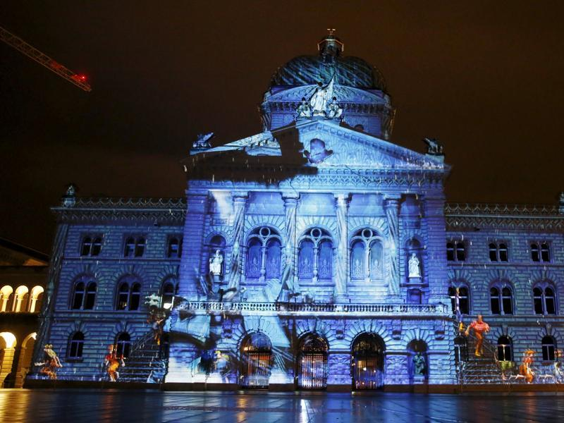 The Swiss Federal Palace (Bundeshaus) is illuminated by giant light projection The Jewel of the Mountains in Bern, Switzerland. (REUTERS)
