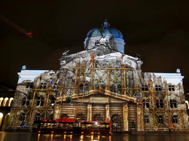 The Swiss Federal Palace (Bundeshaus) illuminated by giant light projection The Jewel of the Mountains in Bern, Switzerland October 15, 2015. (REUTERS)