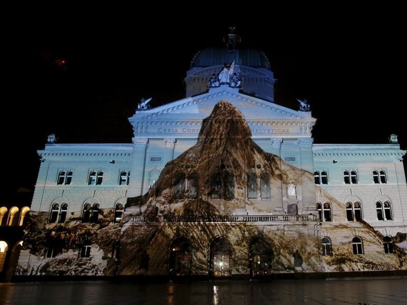 The Swiss Federal Palace (Bundeshaus) is illuminated by a giant light projection of the Matterhorn. (REUTERS)