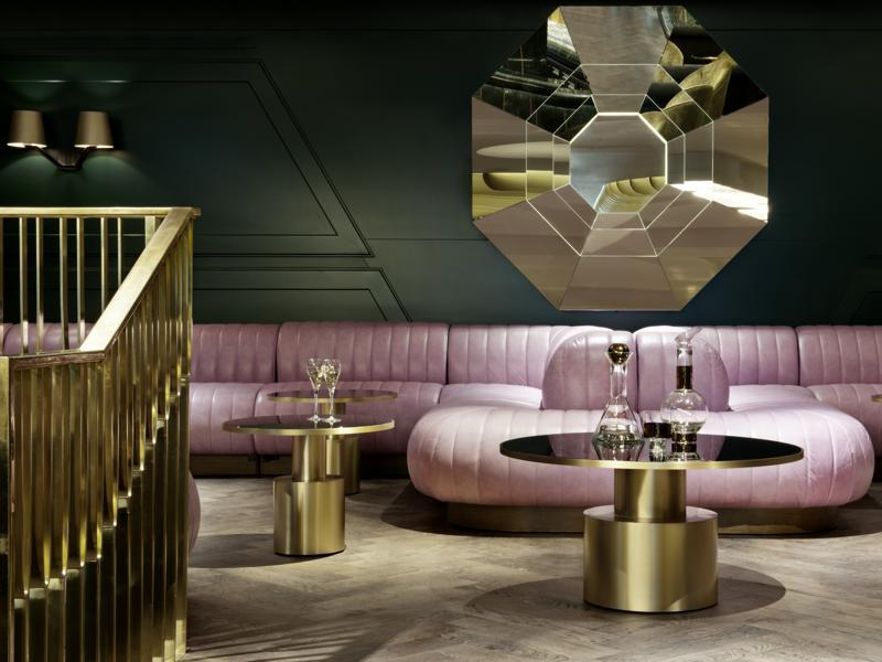 Pink leather banquettes and a marble green bar are used to create a distinctive drinking experience at the Dandelyan bar at the Mondrian hotel in London. (AFP)