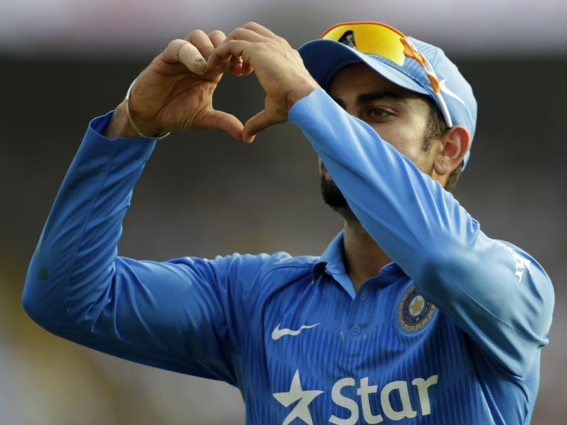 Virat Kolhi gestures towards the crowd during the first innings.  (Kunal Patil/HT Photo)