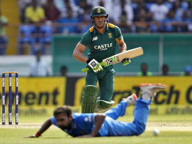 South Africa's Faf du Plessis watches the ball after playing a shot as India's Amit Mishra falls on the ground. (Reuters Photo)