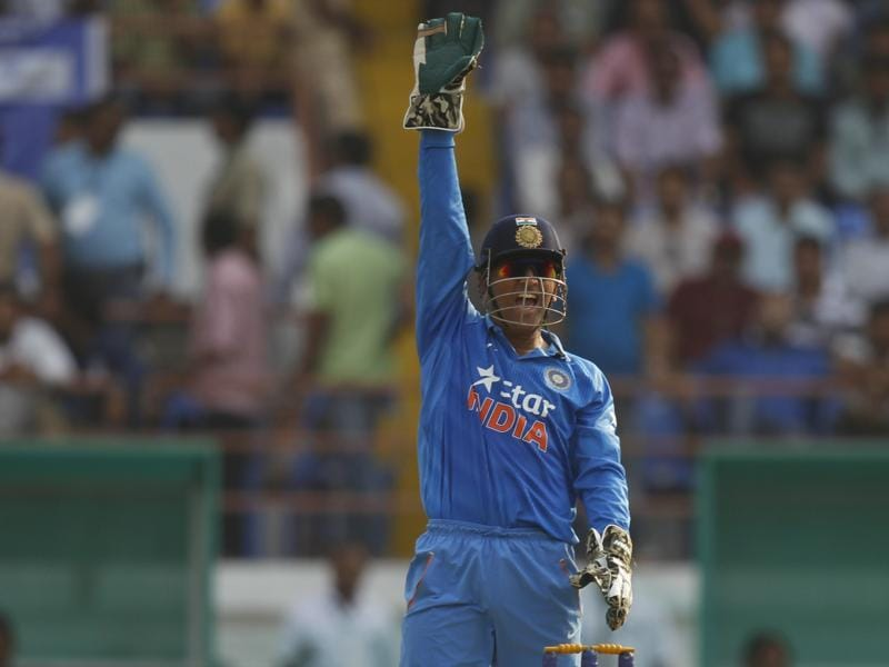 India's captain Mahendra Singh Dhoni appeals for a wicket during the first innings.  (AP Photo)