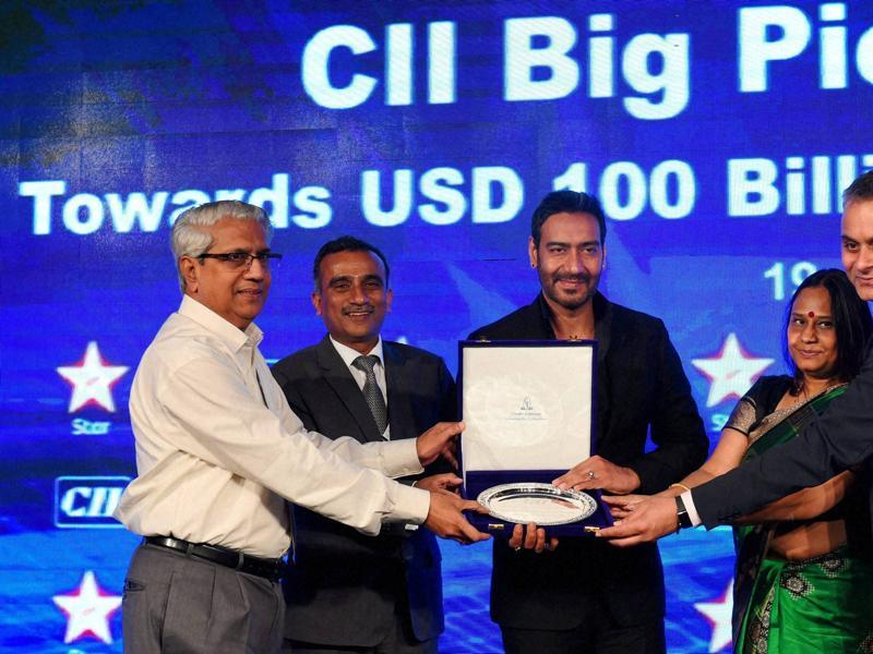 Ajay Devgan receiving a memento from CII officials during the CII Big Picture Summit 2015 in New Delhi on Monday.  (PTI)