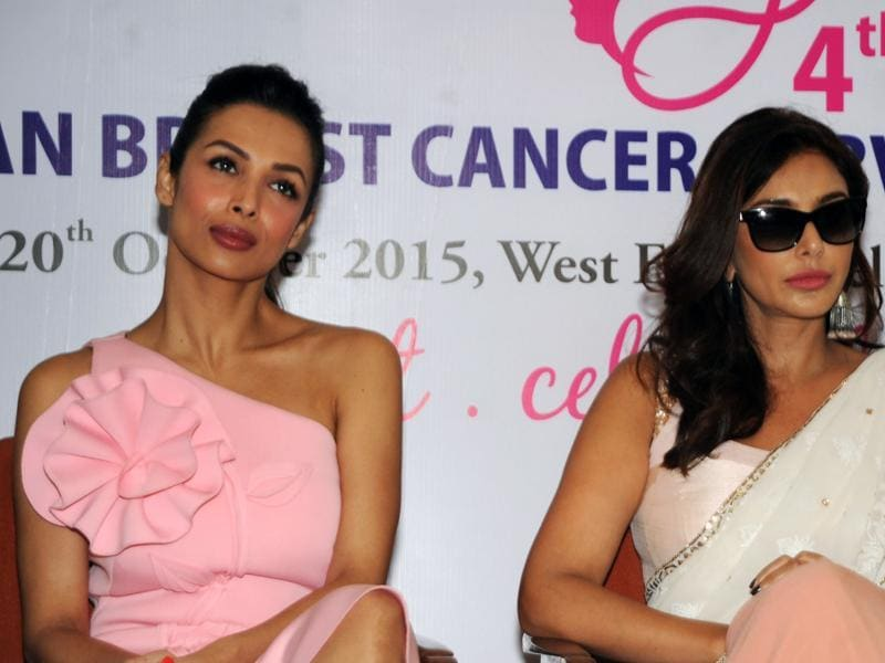Bollywood actors Malaika Arora Khan and Canadian model and Bollywood actress Lisa Ray attend a press conference for supporting the Women's Cancer Initiative in Mumbai on October 19, 2015.  (AFP)