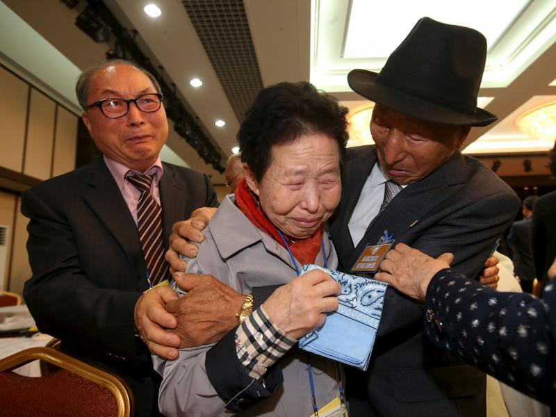South Korean Lee Jin-goo (C) meets her North Korean brother Lee Yong Goo (R) during the separated family reunions at Mount Kumgang resort, North Korea. In an outpouring of emotions and tears, nearly 400 South Koreans crossed the heavily armed border into North Korea to be reunited with family members separated for more than six decades since the 1950-53 Korean War.   (Reuters Photo)