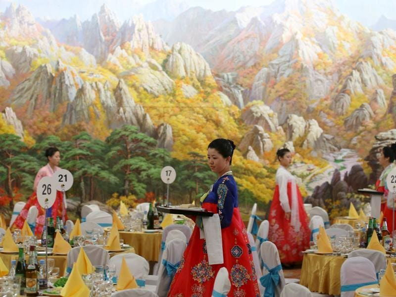 North Korean women prepare for a group luncheon during the separated family reunions at Mount Kumgang resort, North Korea.  (Reuters Photo)