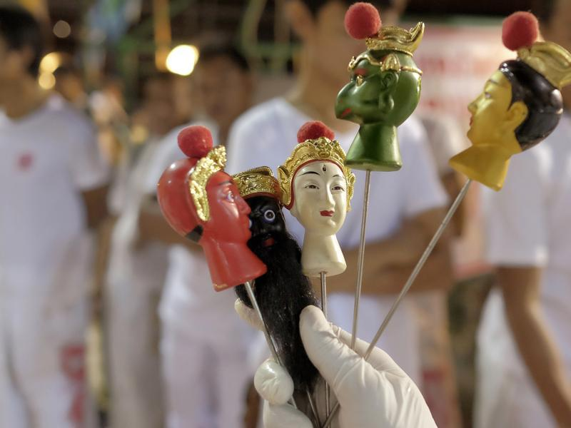 Chinese emperor gods spikes are displayed outside the Chinese shrine of Ban Tha Rue in Phuket. The Vegetarian Festival begins on the eve of the ninth lunar month of the Chinese calendar and is observed primarily in Southeast Asian countries, including Thailand, Malaysia, Singapore and Myanmar.. (AP Photo/David Longstreath) (AP)
