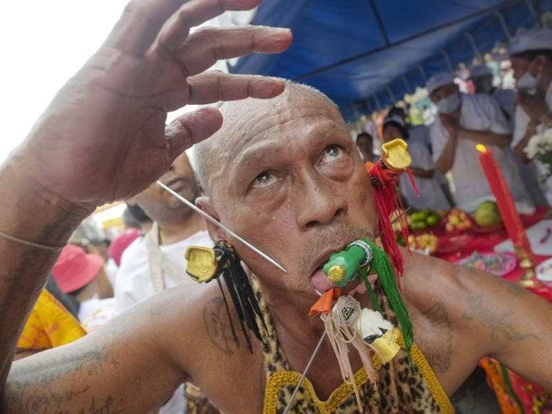 The most striking element of the nine-day celebration has little to do with food. In sacred rituals, devotees work themselves into trances to have all manner of items pierced through their cheeks, from daggers and swords to a bicycle. Then they dance as massive strings of fireworks explode all around them. (AP Photo/David Longstreath) (AP)