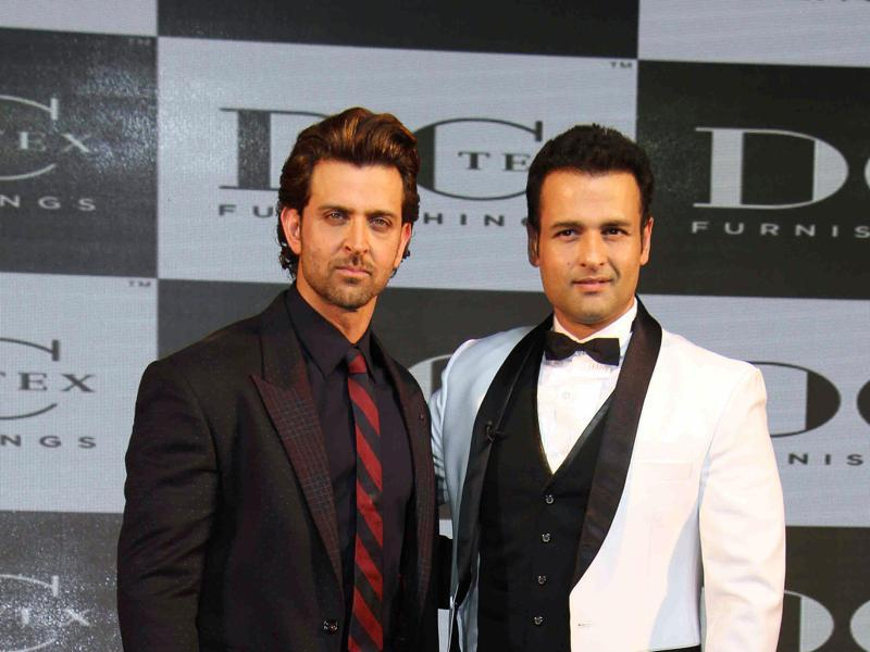 I am hungry now, Rohit stop smiling! Hrithik Roshan and Rohit Roy strike a pose during a corporate event in Mumbai on October 20, 2015.  (AFP)