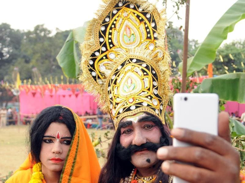 Artists taking a selfie during the Dussehra festival in Jalandhar on Thursday.  (Pardeep Pandit/Ht Photo)