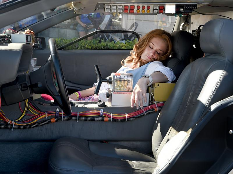 Coral Tinson, playing the part of Jennifer from Back To The Future, pretends to be passed out in the famed DeLorean time machine during Fillmore's movie celebration. (AP)