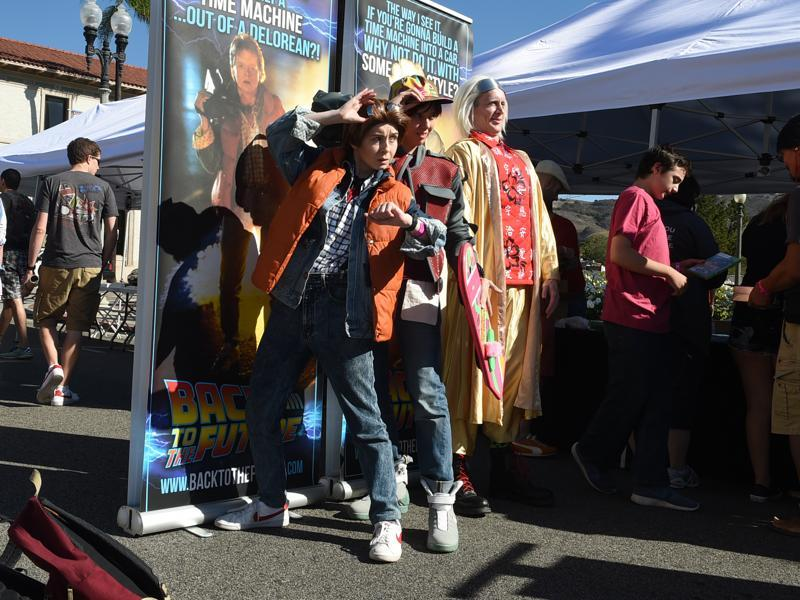 Back To The Future fans dressed as Jennifer, Marty and Doc during the franchise's 30th anniversary celebrations. (AP)