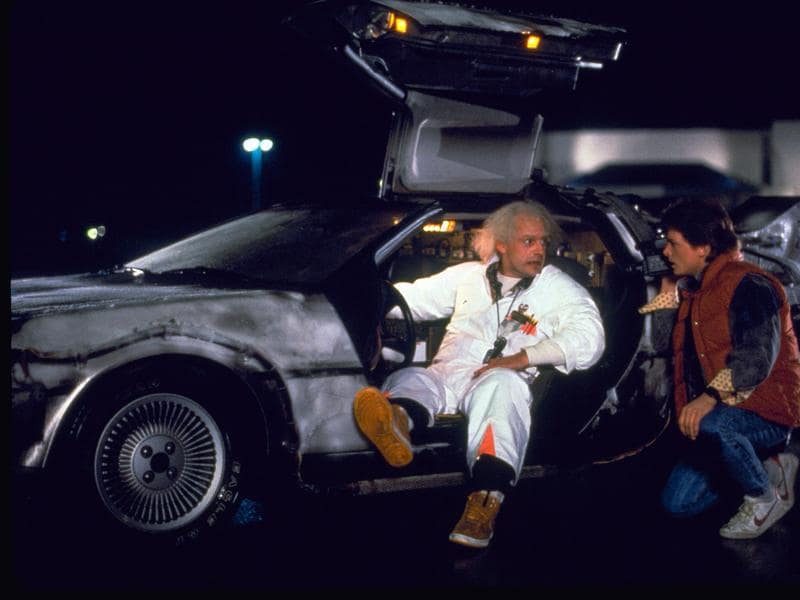 This file photo shows Christopher Lloyd, left, as Dr Emmett Brown, and Michael J Fox as Marty McFly in the 1985 film, Back to the Future. For one day, a picturesque town about 60 miles north of Los Angeles was transformed into Hill Valley, the fictional hometown of McFly from the Back to the Future franchise.  (AP)