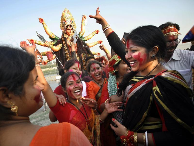 Devotees dance before immersing the idol of goddess Durga in the River Yamuna in New Delhi, India. (Arun Sharma/ Hindustan Times)