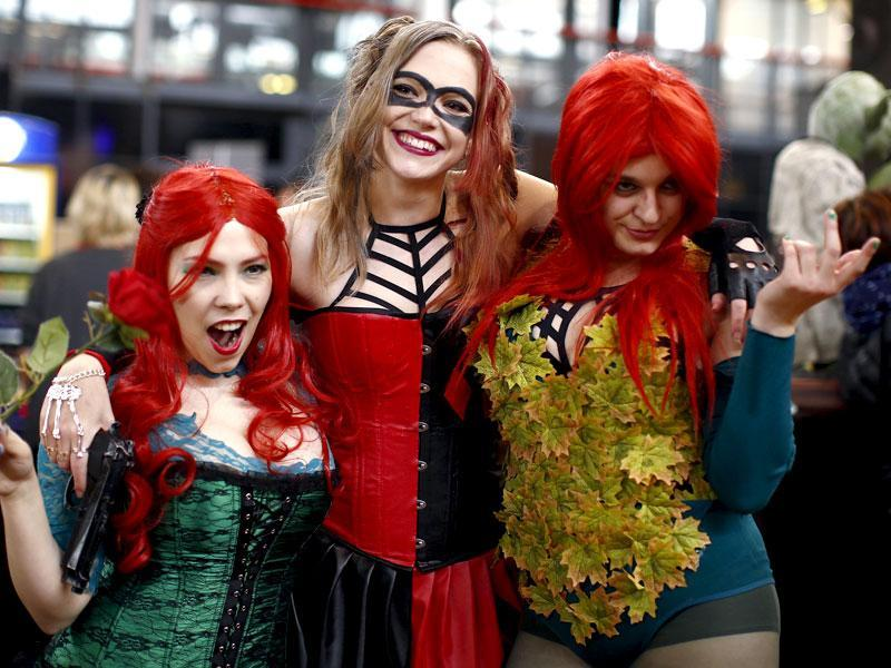 Girls dressed as Poison Ivy and Harley Quinn, a Batman character (centre), pose the first Comic Con convention at the Grande Halle de la Villette, October 23-25, 2015, in Paris. (Reuters)