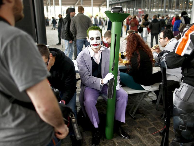 A Paris Comic Con attendee dressed as Joker, a Batman character, waits during the first day of the event in Paris, October 23, 2015. (Reuters)