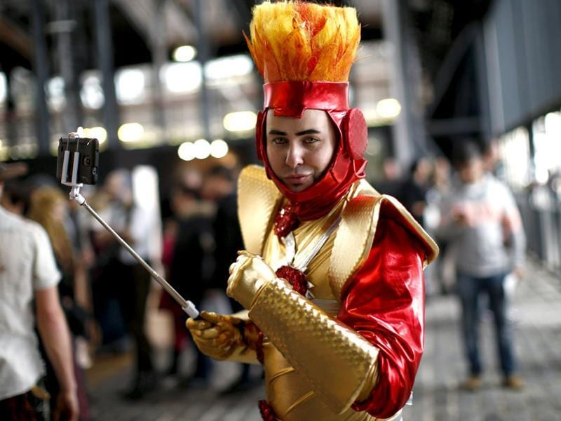 A Paris Comic Con attendee, dress as Firestorm, a DC character, poses during the event in Paris, October 23, 2015. (Reuters)