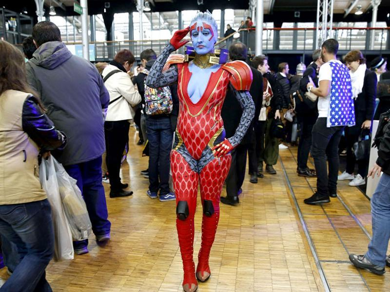 A woman dressed up as Samara, a character from the Mass Effect video game, takes part in the first Comic Con convention on October 23, 2015, in Paris. (AFP)