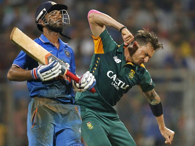 South Africa's Dale Steyn, right, celebrates taking the wicket of India's Ajinkya Rahane during the fifth and final ODI in Mumbai, on October 25, 2015. (Reuters Photo)