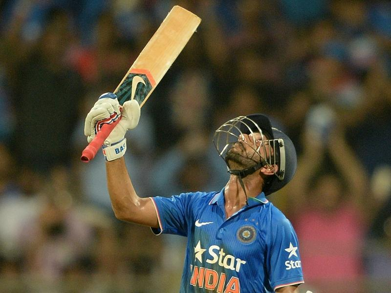 Ajinkya Rahane looks to the heavens in celebration of his half-century. (AFP Photo)