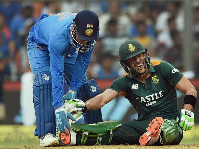 Indian captain MS Dhoni helps Faf du Plessis after the South African suffered from cramps during his knock of 133 retired hurt. (PTI Photo)