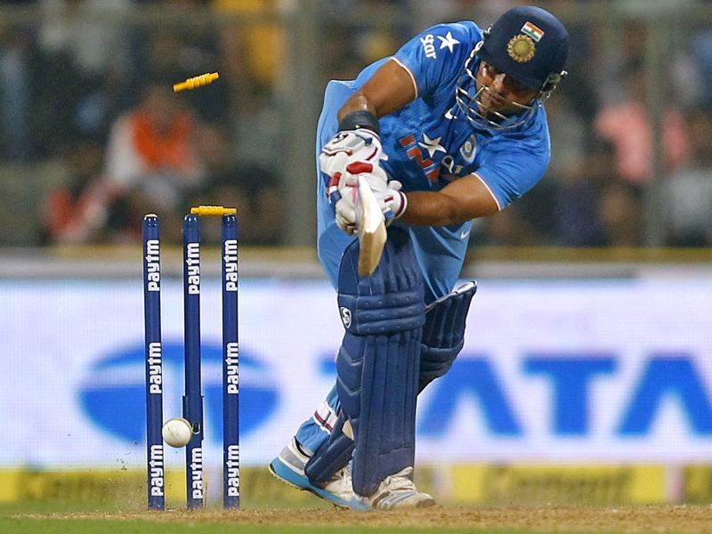 India's Suresh Raina is bowled behind his legs by South Africa's Kagiso Rabada. (Reuters Photo)