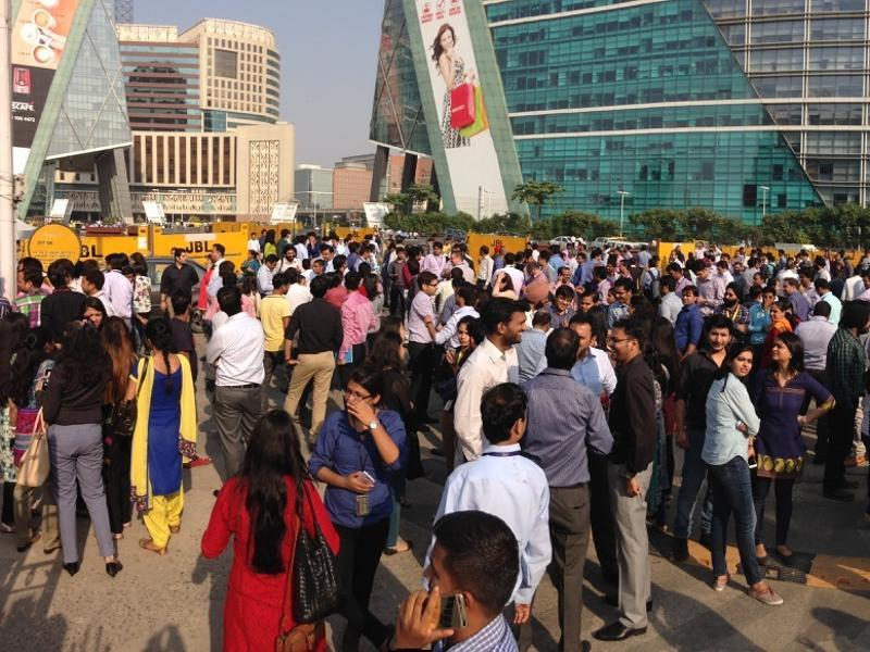 Crowd outside Cyber City after massive tremors in Gurgaon  on Monday. (Gurinder Osan/HT Photo)