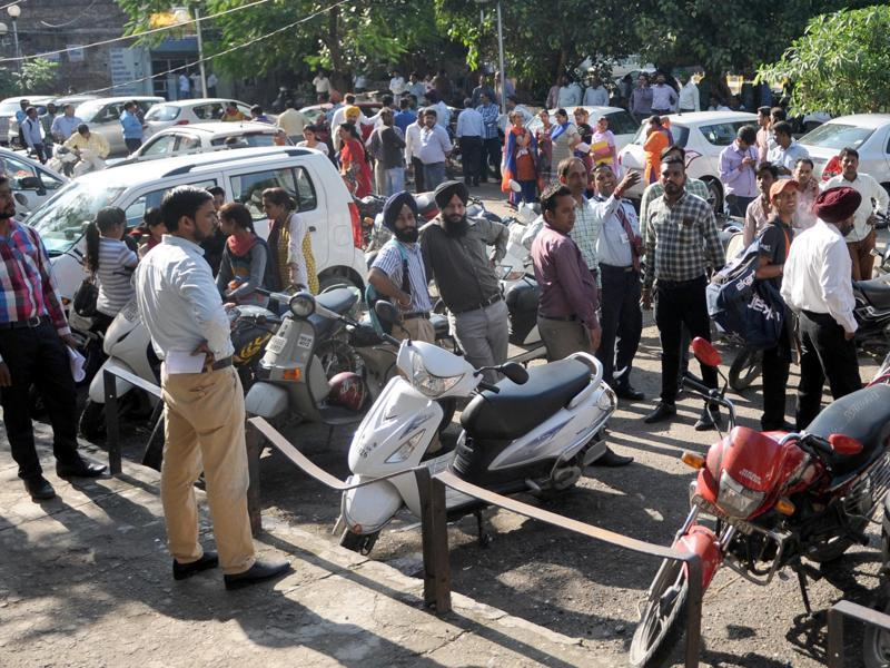 People outside their office after tremors were felt in Jalandhar. (HT Photo )