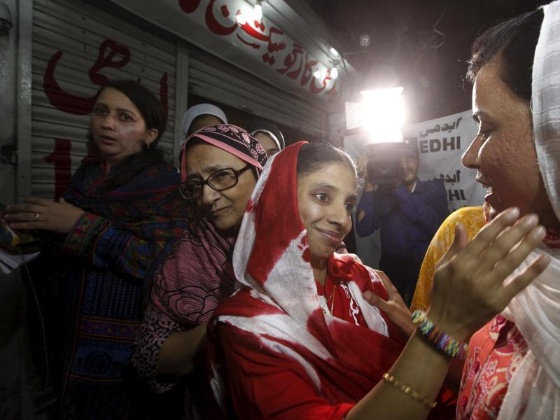 Geeta greets a journalist before leaving for an airport to depart for New Delhi. (Reuters Photo)
