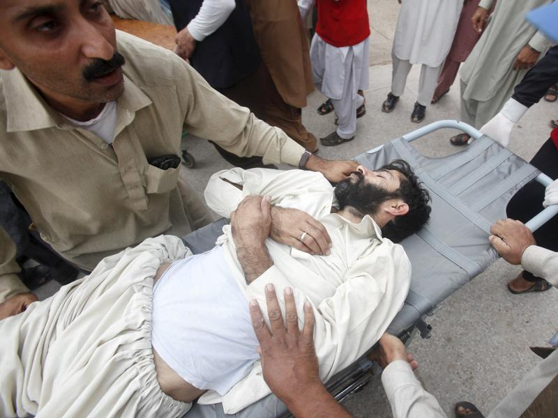 Rescue workers move a man, who was injured during the earthquake, at the Lady Reading hospital in Peshawar, Pakistan. (REUTERS)