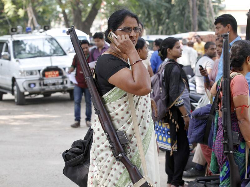 Armed officials on their way to the polling booths in Patna.   (Arvind Yadav/HT Photo)