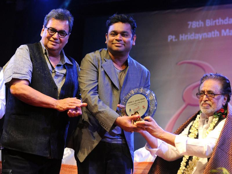 Filmmaker Subhash Ghai (L) and Indian musician AR Rahman (C) pose with music composer Hridaynath Mangeshkar (R) during a function to celebrate his 78th birthday in Mumbai. (AFP)