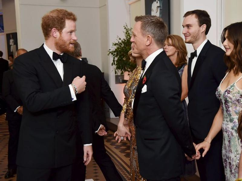 Prince Harry meets the cast and crew of the new James Bond 007 film Spectre before the world premiere at The Royal Albert Hall in London. (REUTERS)