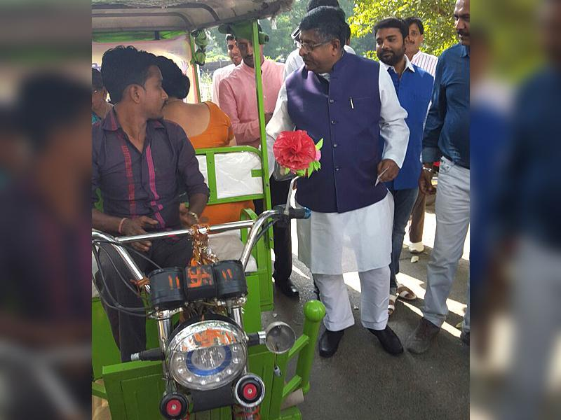 E-rickshaws introduced for voters awareness by the district administers have proved to be a hit. (HT Photo)