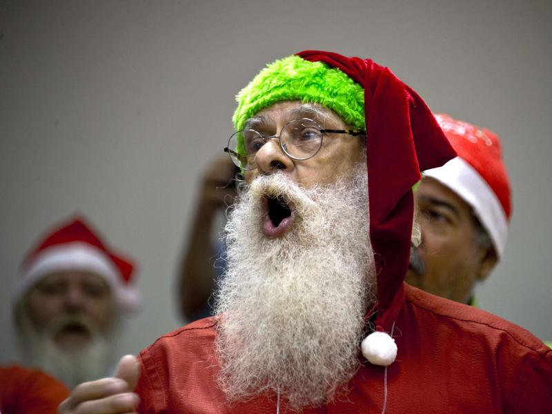 People sing during a lesson at a school for Santa Claus in Rio de Janeiro on October 27, 2015. (AFP)