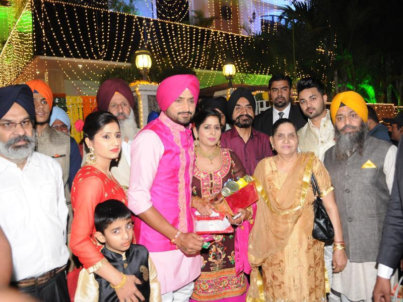 Harbhajan Singh with his family members while leaving for the celebration of sangeet  celebrations in Phagwara, Punjab.  (Pardeep Pandit/HT Photo)