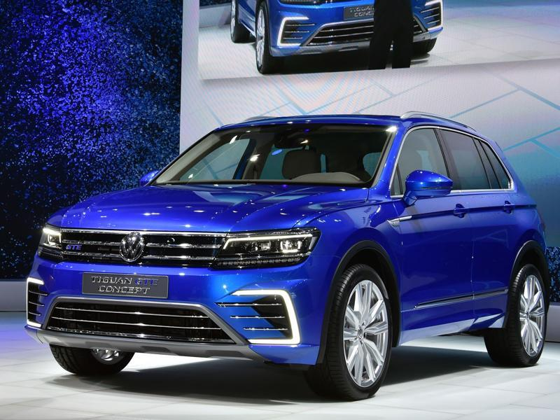 Volkswagen introduces the new Tiguan GTE plug-in hybrid crossover model at the press preview of the Tokyo Motor Show on October 28, 2015. Diess apologised for the company's diesel models scandal. AFP PHOTO / Yoshikazu TSUNO (AFP)