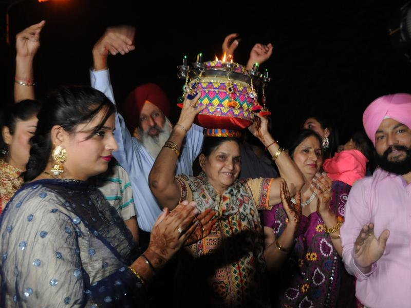 Avtar Kaur mother of Harbhajan Singh along with his younger sister Sandeep Kaur and relatives during Jago celebration on the eve of his marriage in Jalandhar on Wednesday, October 28, 2015.  (Pardeep Pandit/HT Photo)