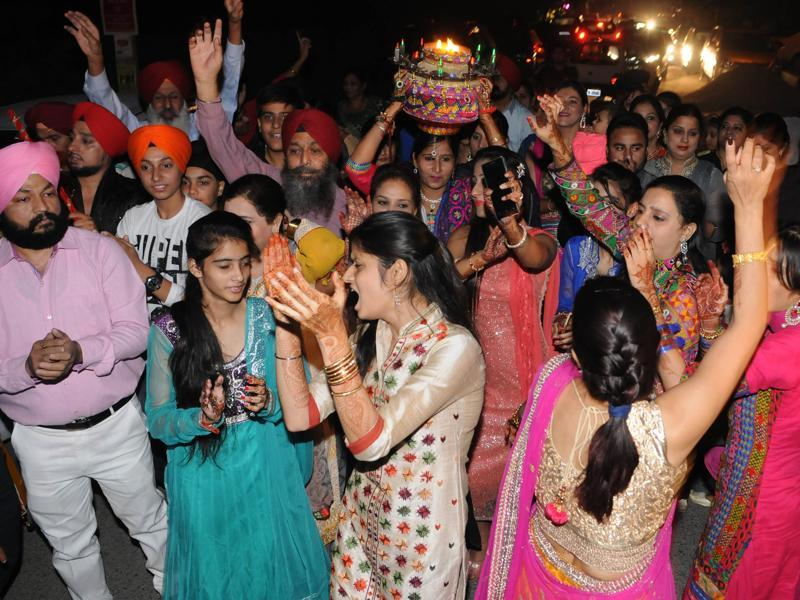 Relatives of Harbhajan SIngh in jubilant mood during  Jago Celebration on the eve of his marriage in Jalandhar, India on Wednesday, October 28, 2015.  (Pardeep Pandit/HT Photo)