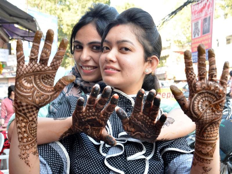 Celebrating with great fervour, married women showing mehndi on their hands on the eve of Karva Chauth in Amritsar on Thursday.  (Sameer Sehgal/ HT photo)