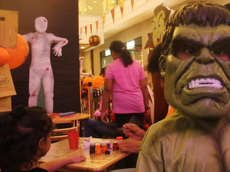 A child shows off his Hulk mask at the Halloween party in Lower Parel, Mumbai. (Pramod Thakur/HT photo)