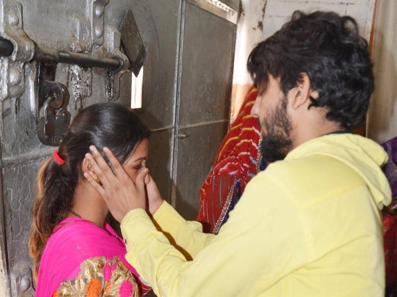 A newly-wed woman meets her husband who is a prisoner at Central Jail Amritsar. The jail authorities had made special arrangements on the occasion of 'Karva Chauth' in Amritsar on Friday. (Sameer Sehga/ HT photo)