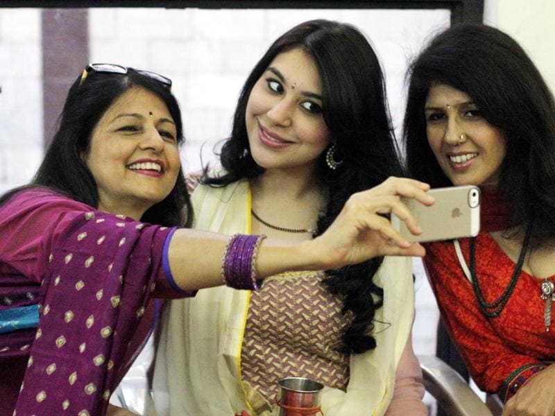 Women click a 'selfie' on the occasion of Karva Chauth, in New Delhi.  (Sanchit Khanna/HT Photo)